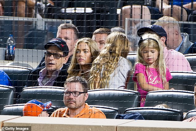 They have tried to be friends: Charlie Sheen (L) and Denise attend the New York Yankees vs New York Mets game at Citi Field in 2012 in New York City with their two kids