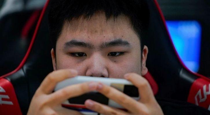 Kids can be seen playing video games in this image from China