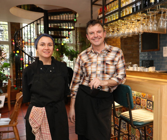 Steve Clarke (R) and business partner Bonita de Silva at Cafe Van Gogh.