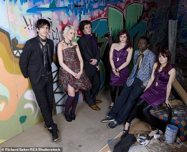The whole gang: The twin sisters are pictured with the Skins cast, includingLuke Pasqualino, in 2009