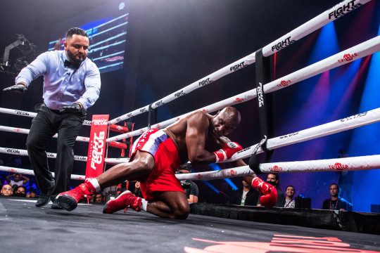 Evander Holyfield also slipped to the floor after missing with a left hook