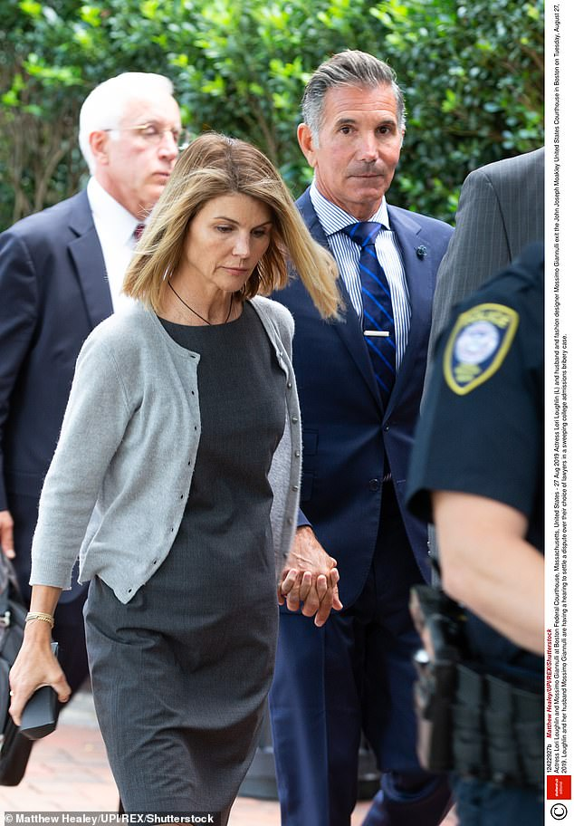 On the outside: Lori and husband Massimo Giannulli pleaded guilty after initially claiming they were innocent. Mossimo was sentenced to five months, but both are now free; seen in Boston in 2019