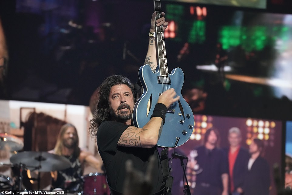 Global:The Foo Fighters presented a medley of their hit songs before being presented with the Global Icon award