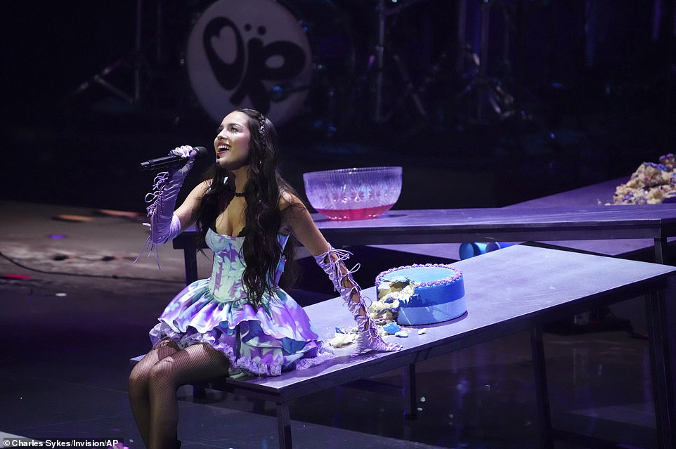 New mood: Olivia Rodrigo completely changed the mood of the show when she took the stage just as Bieber departed for a rocking version of her angry breakup song Good 4 U