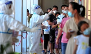 Residents in Putian city in Fujian Province queue to be tested for coronavirus on Monday