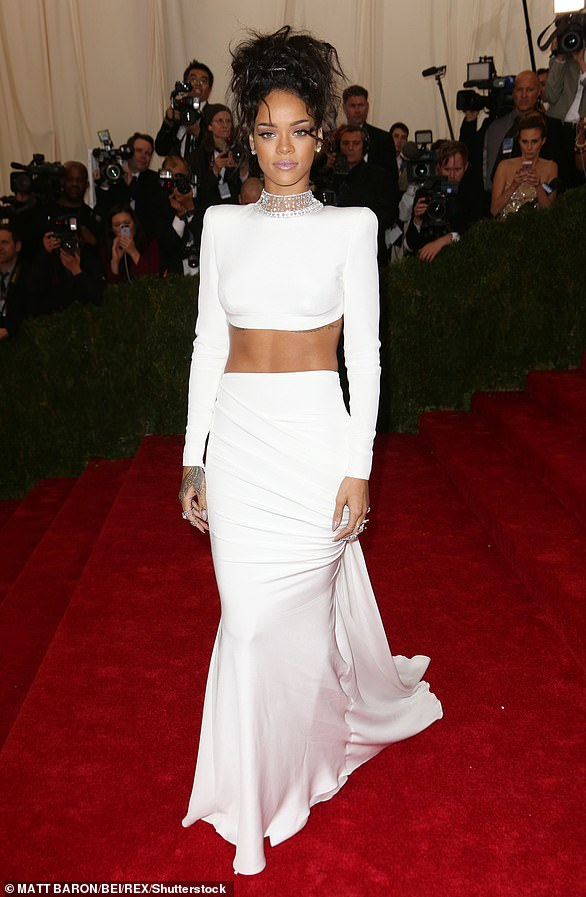 2014:At the event honoring designer Charles James, the Umbrella songstress flashed her midriff in a cropped top with a jeweled collar and matching floor-length skirt by Stella McCartney