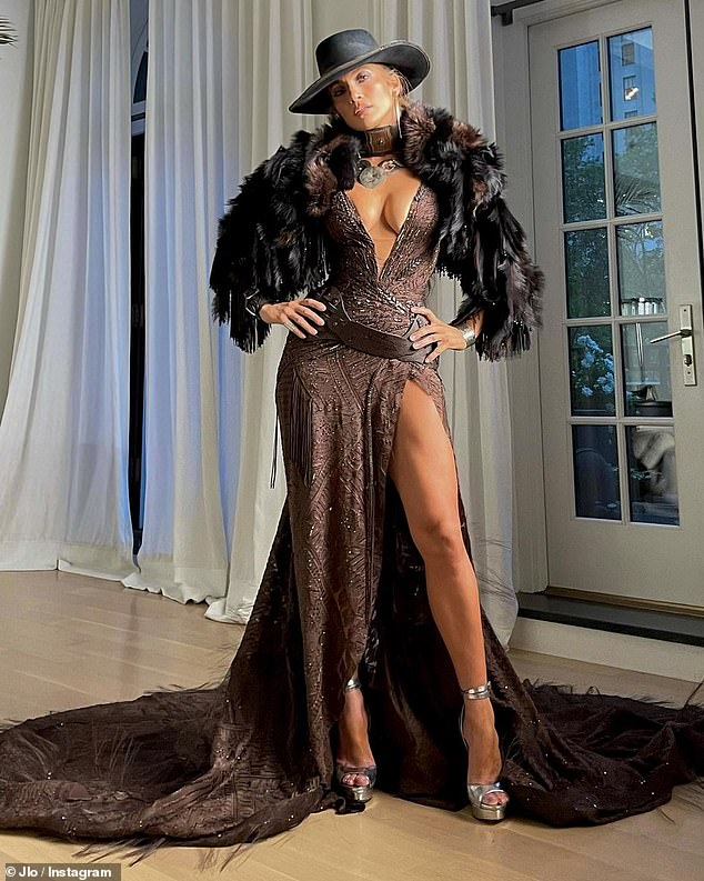 All eyes on her: Similarly, J-Lo stunned in a sexy Ralph Lauren-designed cowgirl getup featuring a plunging textured gown with a dramatic leg slit.