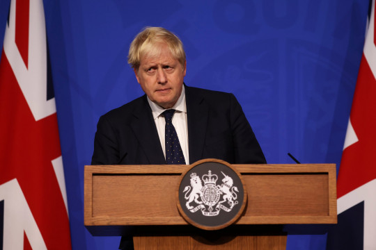 LONDON, ENGLAND - SEPTEMBER 14: Britain's Prime Minister Boris Johnson attends a press conference in the Downing Street Briefing Room on September 14, 2021 in London, England. The prime minister's briefing was preceded by his health secretary's appearance before the House of Commons, in which he laid out the country's strategies for managing the pandemic through the autumn and winter. (Photo by Dan Kitwood-WPA Pool/Getty Images)