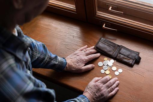 Old man's hands, count money.