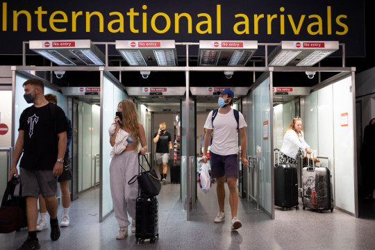 Travellers arrive in Gatwick Airport