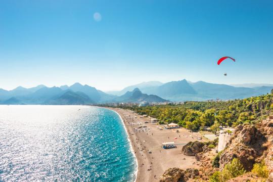 Panoramic bird view of Antalya and Mediterranean seacoast and beach with a paraglider, Antalya, Turkey, Autumn