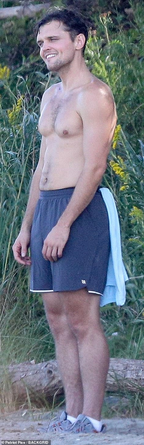 Convenient: He had a blue towel tucked into his swimming trunks