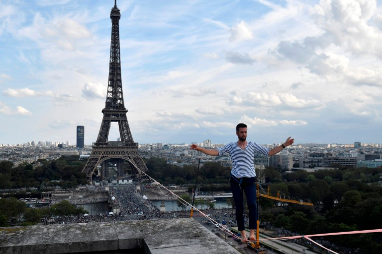 French acrobat Nathan Paulin arrives at the Theatre National de Chaillot after walking a highline from the Eiffel Tower across the Seine River, as part of events around France for National Heritage Days Paris Saturday, Sept.18, 2021.