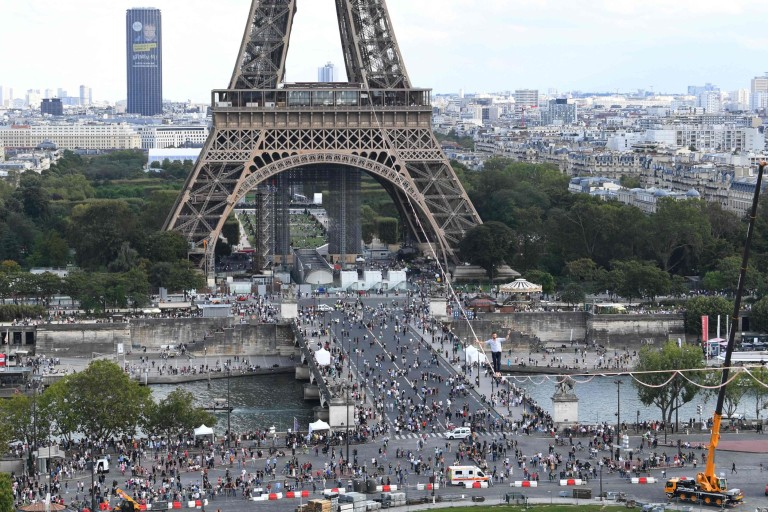 French highliner Nathan Paulin performs on a 70-metre-high slackline spanning 670 metres between the Eiffel Tower and the Theatre National de Chaillot, as part of the 38th European Heritage Days and the launch of the Cultural Olympiad in Paris, on September 18, 2021.