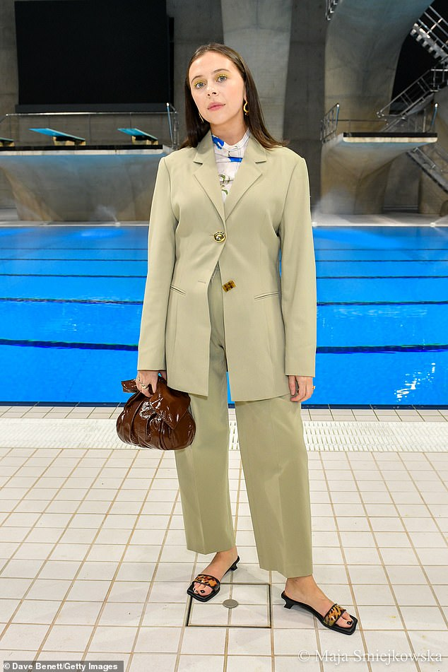 British-raised actress: Bel, 29, whose father is English thespian Mark Powley, went for a conservative look with tortoiseshell sandals and toted a toffee-hued leather purse
