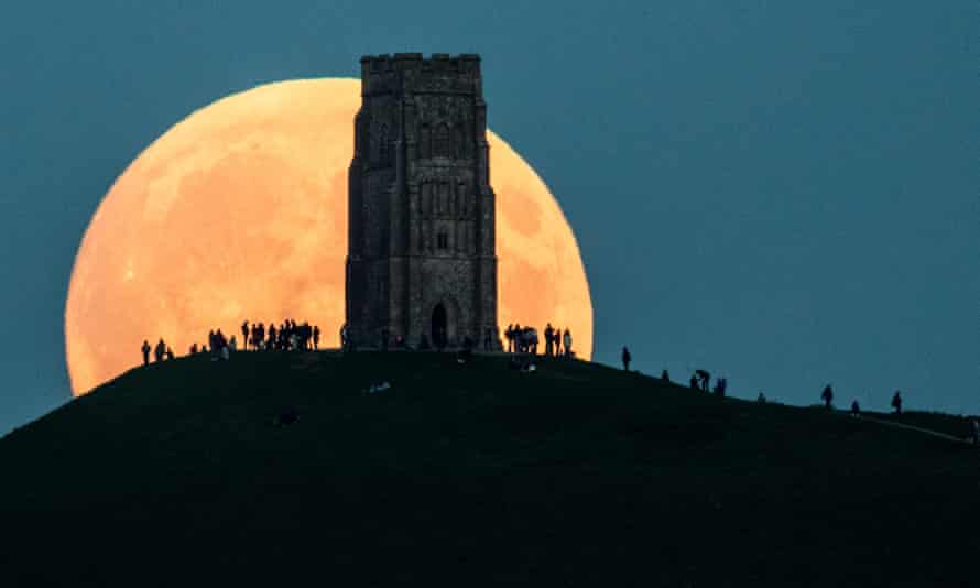 The supermoon rises behind Glastonbury Tor in England on 27 September 2015.