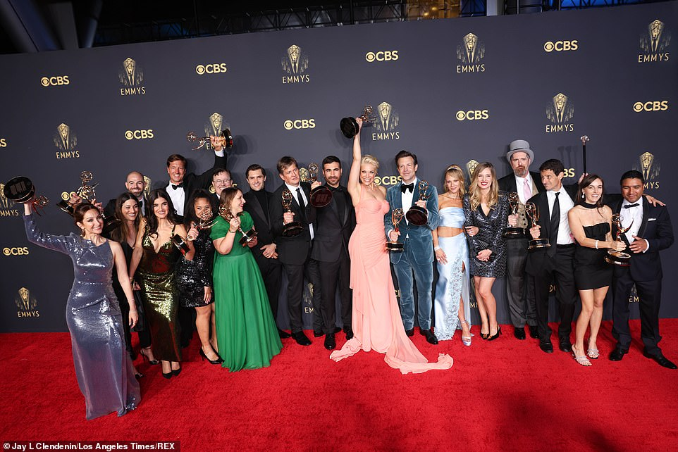 Incredible showing: Most of the primary cast and creative team assembled in the winners' room, with nearly enough Emmys for each person, which they raised in the air triumphantly