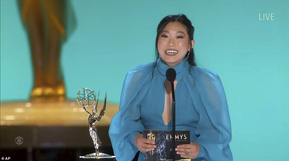 Blue mood: Awkwafina skipped the red carpet but glowed in a sheer blue dress as she presented the Emmy for Outstanding Comedy Series to Ted Lasso
