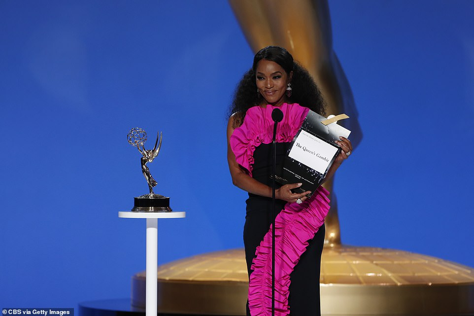 Gorgeous: Angela Bassett looked glamorous in a black dress with a pink frill as she announced The Queen's Gambit as the winner of Outstanding Limited or Anthology Series