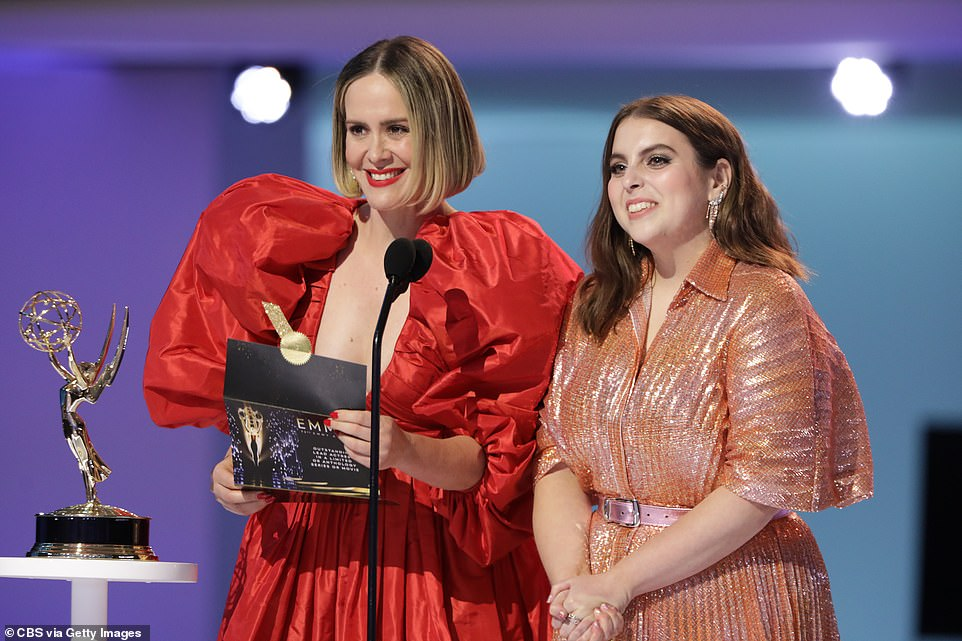 Costars: Impeachment: American Crime Story stars Sarah Paulson (L) and Beanie Feldstein (R) presented Winslet with her award. Paulson sizzled in a puffy red dress while Feldstein shimmered in a golden pleated look