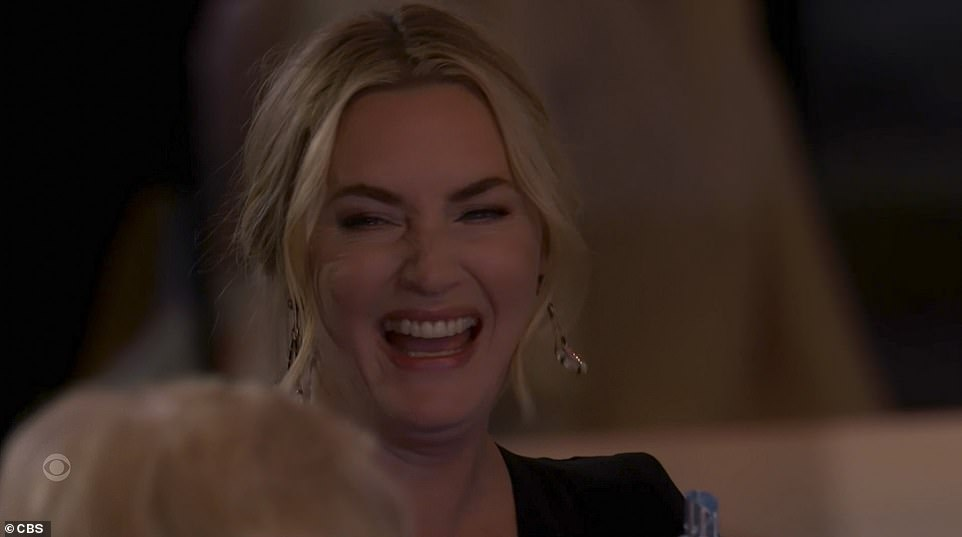 Thanks: Julianneoffered kind thanks to the show's star Kate Winslet. 'Man, you're good at acting,' she joked, before thanking the Titanic star for talking her into doing the series