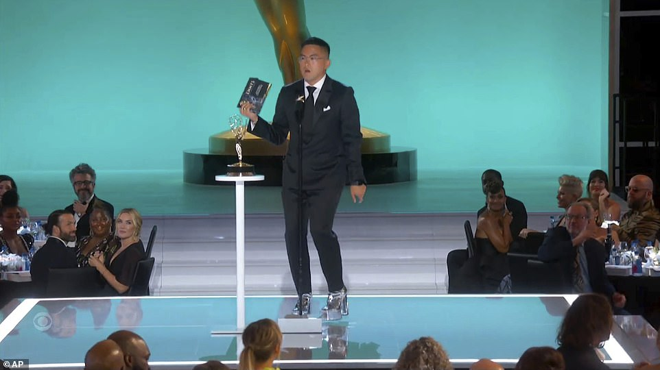 Getting a workout: SNL's Bowen Yang wore silver platform heels before presenting the Lead Actress in a Comedy award. He joked he just needed to get in his '10,000 steps,' even though he still had '8,500 to go.' He slowly walked to the microphone