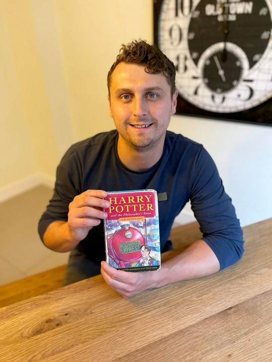 a man named harry potter with the first edition hary potter book he plans to sell