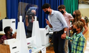 Liberal leader Justin Trudeau votes with the help of his children, clockwise from top, Xavier, Ella-Grace and Hadrien, in his riding of Papineau, Montreal, Quebec.