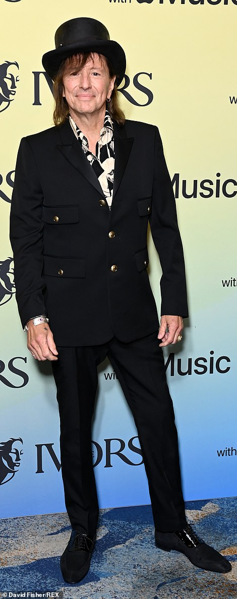 Rock on! Bon Jovi starRichie Sambora, 62, looked like rock royalty in a stylish black number with a top hat
