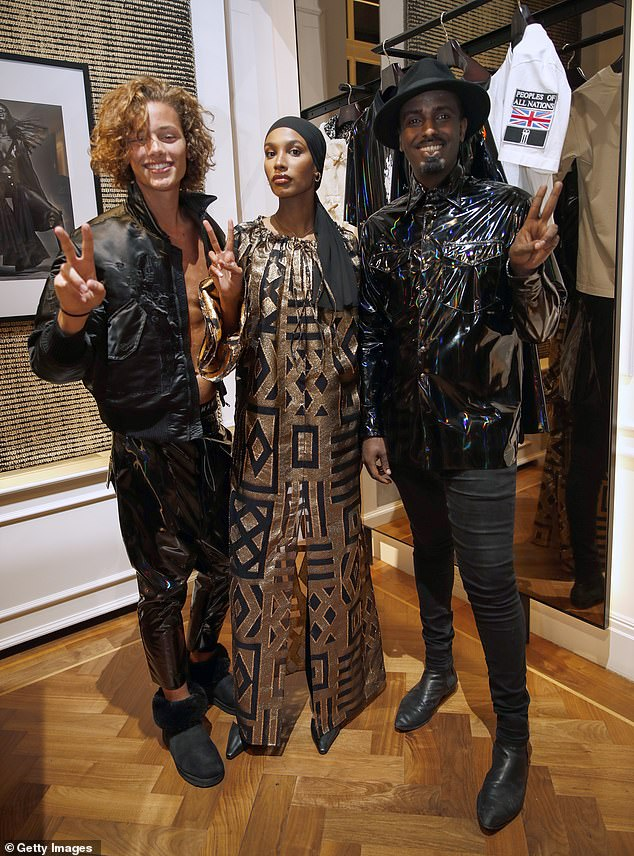 Squad goals:It wasn't long before he joined his modelling pals Ikram Abdi Omar and Mason Smillie for a high-spirited group snap, which saw the trio flashing a peace sign