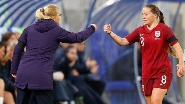 Fran Kirby fist pumps England manager Sarina Wiegman