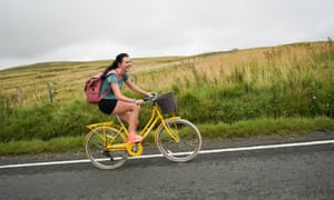 A woman cycles up Hartside hill in Alston, United Kingdom.