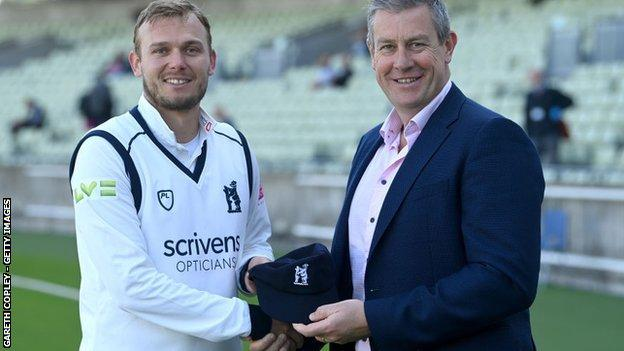 Danny Briggs received his Warwickshire county cap from another Bears and England left-arm spinner, Ashley Giles