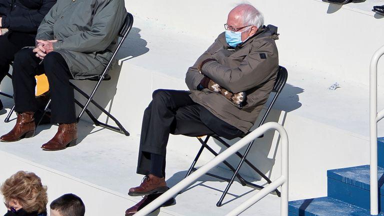 U.S. Senator Bernie Sanders sit socially distanced as he attends the Presidential Inauguration of Joe Biden on the West Front of the U.S. Capitol in Washington, U.S. January 20, 2021. Picture taken January 20, 2021. Caroline Brehman/Pool via REUTERS