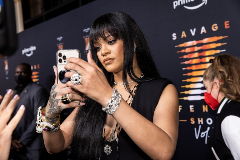 Rihanna records a video during the premiere of Rihanna's Savage X Fenty Show Vol. 3 event in New York City, U.S., September 22, 2021. REUTERS/Stephen Yang
