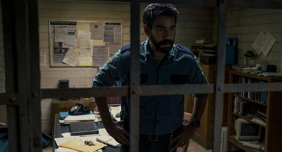 MIDNIGHT MASS (L to R) RAHUL KOHLI as SHERIFF HASSAN in episode 101 of MIDNIGHT MASS Cr. EIKE SCHROTER/NETFLIX © 2021