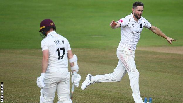 Chris Woakes takes the wicket of Jack Leach