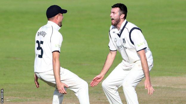 Warwickshire captain Will Rhodes (left) celebrated with England's Dom Sibley as he became the seventh Bears captain to lead his team to the title