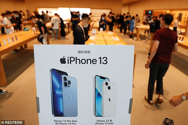 Apple CEO Tim Cook said'These are the best iPhones we've ever created,' noting Apple's work to design the 'very best products and services to enrich people's lives'. Pictured is the inside of a store inBeijing, China on Friday
