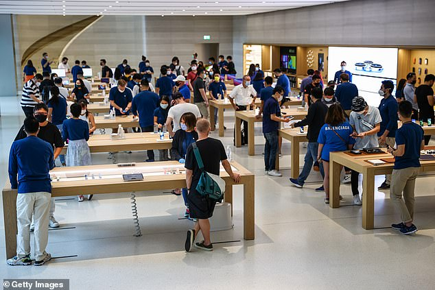 Inside the Singapore Apple Store on Friday where people try out the newly released products