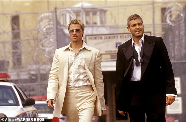 Doing their thing: Clooney and Pitt notably both starred in the highly successful Ocean's series; the pair seen in Ocean's 11