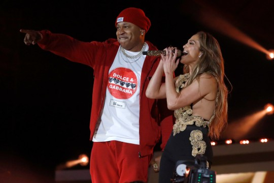 LL Cool J and Jennifer Lopez perform onstage during Global Citizen Live