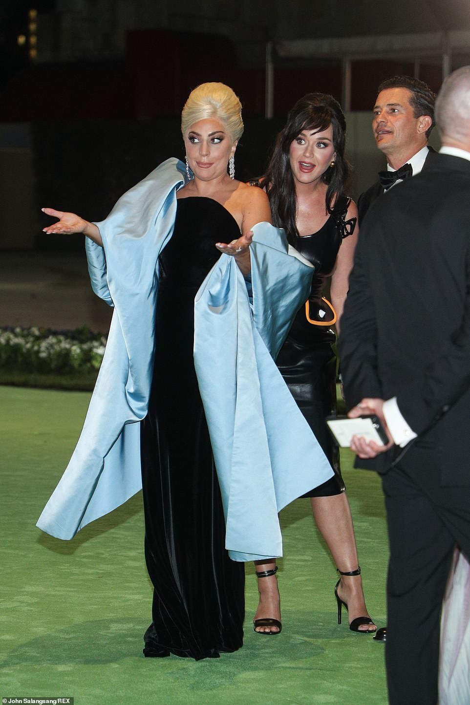 Having a laugh: Lagy Gaga larked around on the red carpet with Katy and Orlando