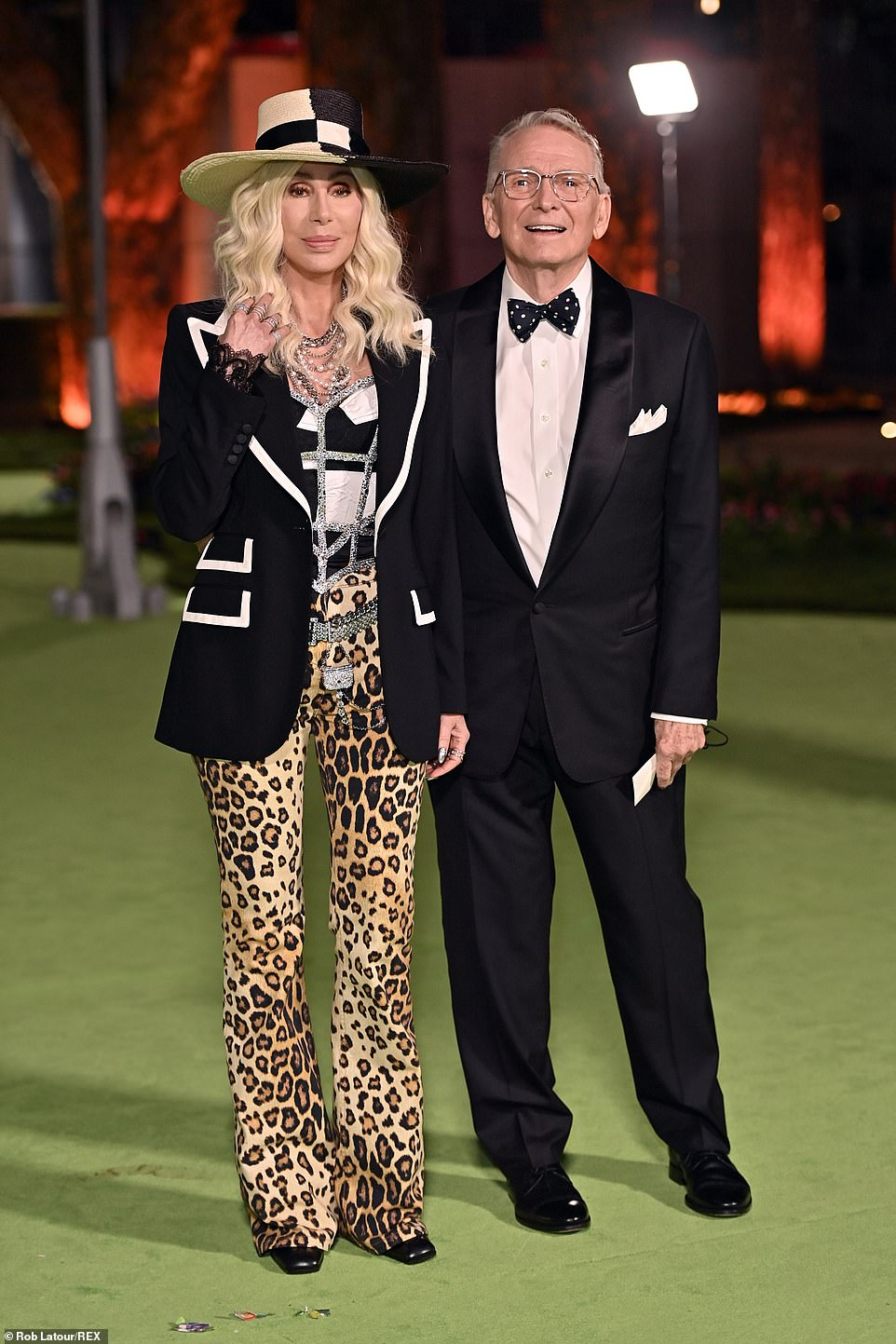Icon: Cher showed off her wild side in leopard pants as she posed with Bob Mackie