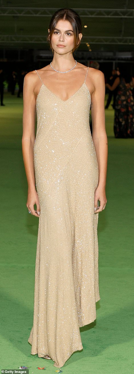Sparkler: Kaia glowed in a golden dress with a waffle print and glittering sequins