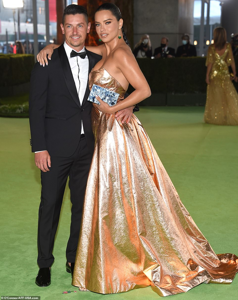 Power couple: Adriana Lima was also seen taking a picture with her boyfriend as they spent time outside of the Museum