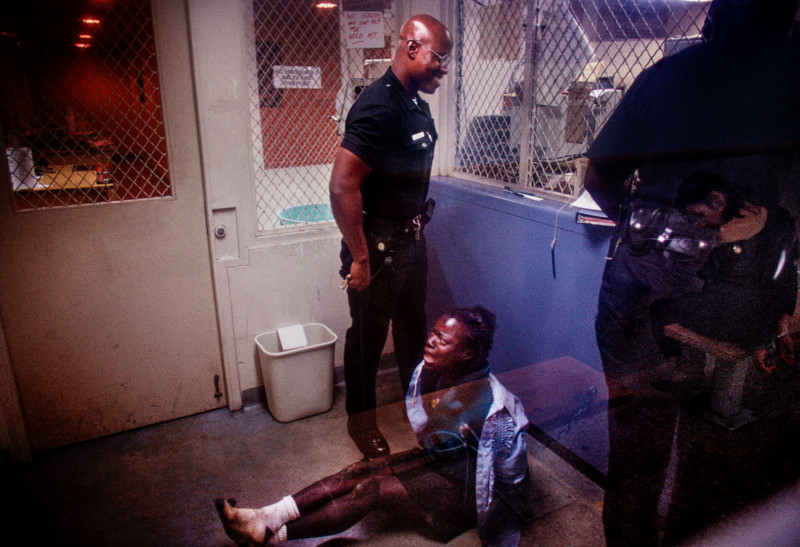 Rampart Division Officers detaining an arrested woman.