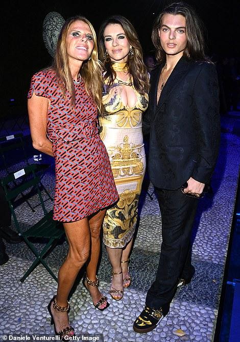 Trio:Anna Dello Russo wore a pretty mini dress for the night out