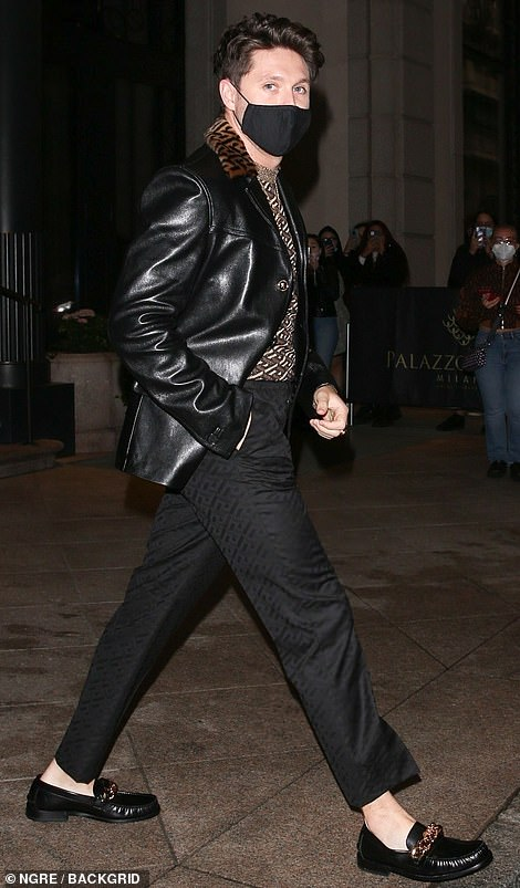 Dapper: One Direction star Niall Horan pulled out all the fashionable stops in Milan as he arrived in a leather jacket, tailored trousers and a face mask