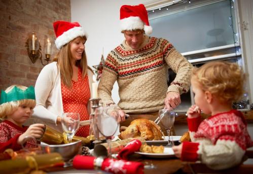 Parents and children having christmas dinner